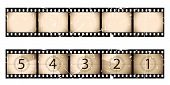 Old sepia film strip and countdown