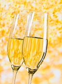 Champagne Flutes On Golden Light Background, Luxury Concept