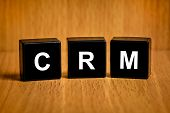 Crm Or Customer Relationship Management Word On Black Block