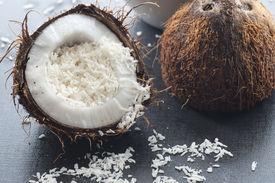 foto of grating  - Grated organic coconut in a half fresh coconut - JPG