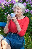 Senior Woman Enjoying The Aroma Of Her Coffee