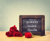 There Is Always A Reason To Smile Message Written On Chalkboard