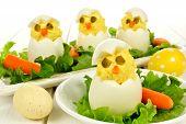 foto of boil  - Fun Easter breakfast of hatching chicks made of boiled eggs - JPG