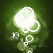 eps10 vector silhouette geometric round rings bubbles with light flares on blurred green background