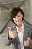 Young business woman give you an Excellent gesture, closeup portrait.