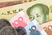 Chinese Or Yuan Banknotes Money And Coins From China's Currency, Close Up View As Background