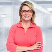 image of mature adult  - Mature business woman on modern office background - JPG