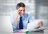 Man having a headache. Stress and depression.