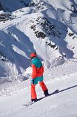 Snowboarder on the mountain slope, extreme sport