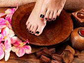 picture of black woman spa  - Beautiful women legs with black pedicure after Spa procedures  - JPG