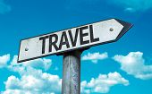Travel sign with sky background