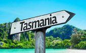Tasmania sign with a beach on background