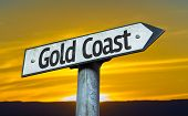 Gold Coast sign with a sunset background