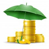 Four stacks of golden coins under an green umbrella