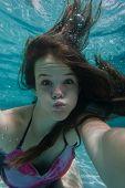 image of playtime  - Girl teenager swimming pool underwater portrait summer playtime - JPG