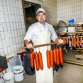 Butcher Prepares Fresh Sausage