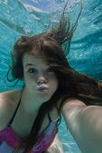 picture of playtime  - Girl teenager swimming pool underwater portrait summer playtime - JPG