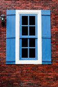 Red Brick With Blue And White Window