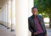 African American Young Man Smiling In Black Leather Jacket
