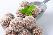 stock photo of truffle  - Chocolate truffles rolled in coconut flakes - JPG