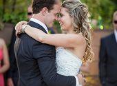 Happy newlyweds dancing on their wedding day