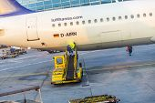 Worker Loads Cargo To Aircraft In Frankfurt