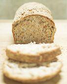 stock photo of fresh slice bread  - Fresh homemade sliced whole wheat grain bread - JPG