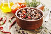 stock photo of stew  - Meat stew with red beans and chili pepper on the table - JPG