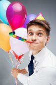 Young office manager holding baloons