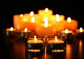 image of rest-in-peace  - Burning candles on dark background - JPG
