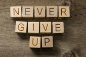 Never give up text on a wooden background