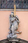 GRAZ, AUSTRIA - JANUARY 10, 2015: Archangel Michael on the portal of Dreifaltigkeitskirche ( Holy Trinity ) church in Graz, Styria, Austria on January 10, 2015.