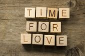 text time for Love on a wooden background