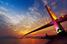 foto of hong kong bridge  - Night scene of Tsing Ma Bridge with illuminated light in Hong Kong - JPG