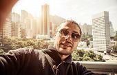 stock photo of pov  - man taking selfie in hong kong - JPG