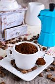 image of coffee grounds  - Ground coffee rests in a ceramic Cup - JPG