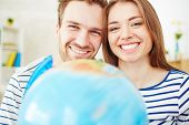 pic of amor  - Amorous couple looking at camera with toothy smiles - JPG