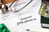stock photo of pneumonia  - Diagnostic form with Diagnosis pneumonia  and pills - JPG