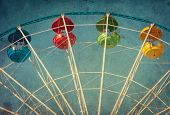 stock photo of ferris-wheel  - Vintage grunge background with colorful ferris wheel - JPG