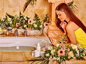 image of black woman spa  - Woman with black long hair relaxing at water spa - JPG
