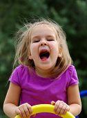 stock photo of playground  - little girl on the playground - JPG
