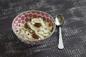 picture of pecan  - cottage cheese with honey and pecans in a bowl on a vintage dark brown wooden background - JPG