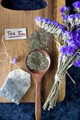 stock photo of tea bag  - tea time tag with tea bag and peppermint tea on spoon in relaxing mood - JPG