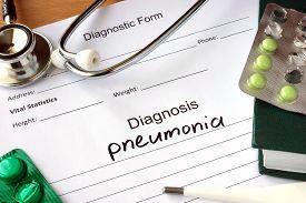 foto of pneumonia  - Diagnostic form with Diagnosis pneumonia  and pills - JPG