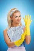 Beautiful happy housewife with rubber gloves