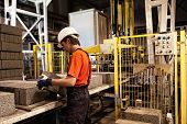 stock photo of factory-worker  - Factory loader at work - JPG