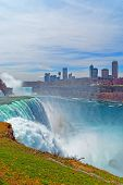 Постер, плакат: Niagara Falls And Skyscrapers In Canada