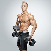 Handsome Athletic Guy Workout With Dumbbells poster