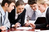 picture of business meetings  - Portrait of confident business people interacting in the office - JPG