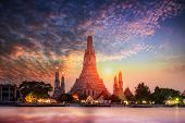 Wat Arun Temple At Sunset In Bangkok Thailand. Wat Arun Is Among The Best Known Of Thailands Landma poster